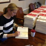 Signing 700 copies of REVENGE for Gilt City NYC and LA